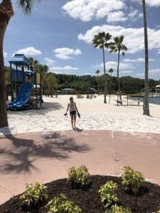 girl standing by playground at Walt Disney World Swan resort