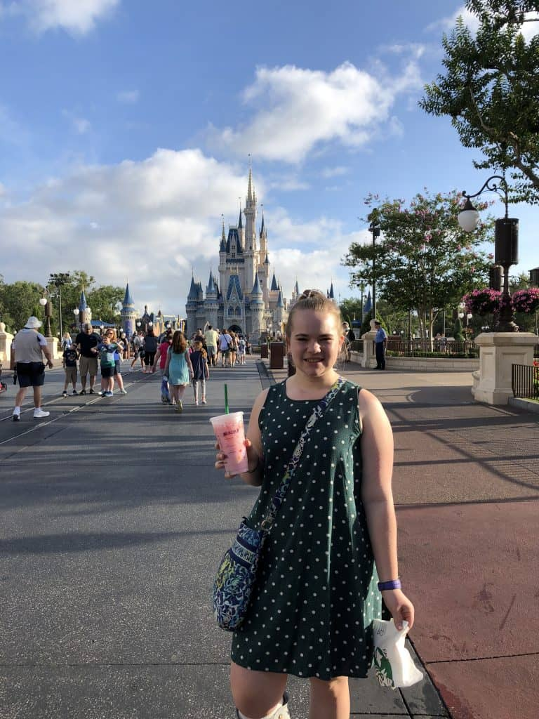 Starbucks Pink drink infront of Cinderella Castle