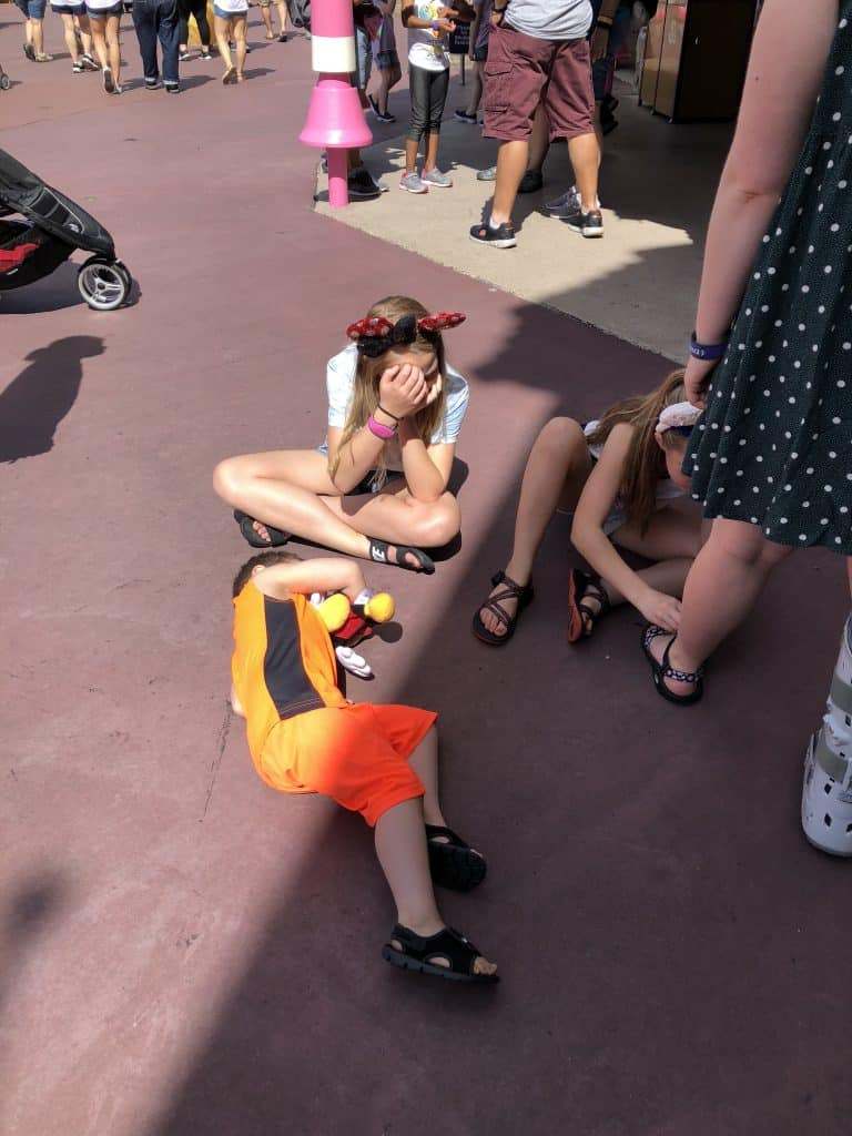 kids laying down at Disney