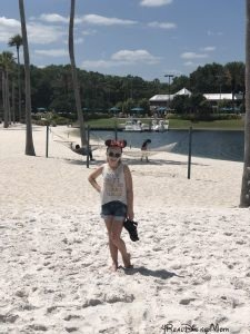 girl standing in sand at Swan resort in Walt Disney World-disney trip report