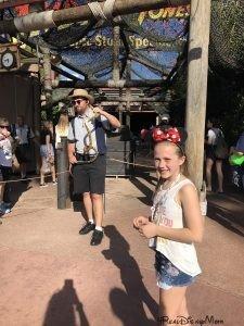girl standing in front of Indiana Jones