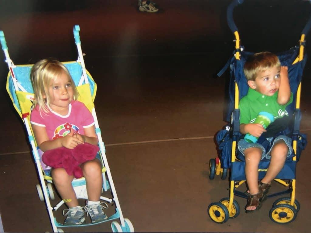 kids in single strollers at Disney
