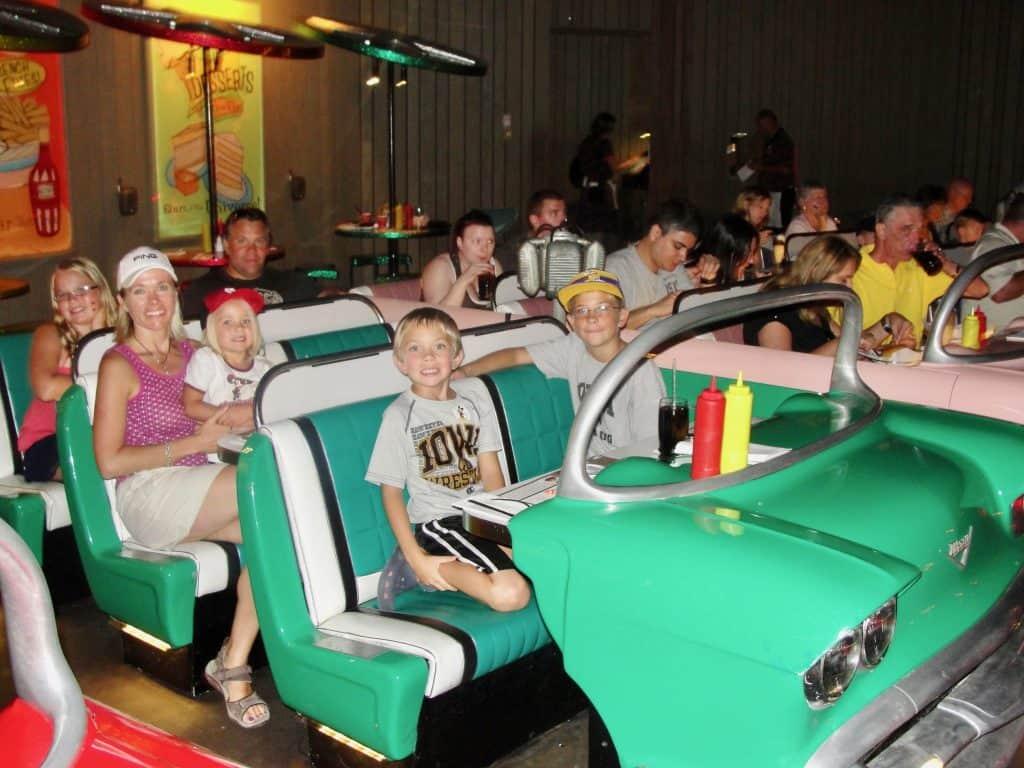 kids sitting in car at Sci-fi